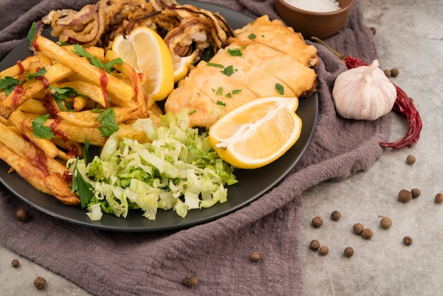 Delicious french fries salad and meat