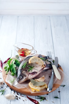 Delicious fresh fish on vintage background.