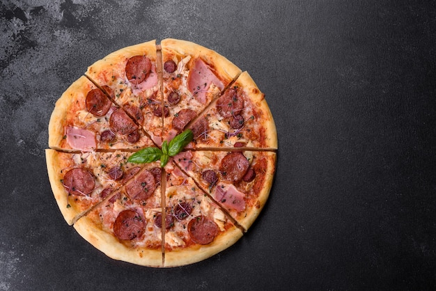 Delicious fresh oven pizza with tomatoes, salami and bacon