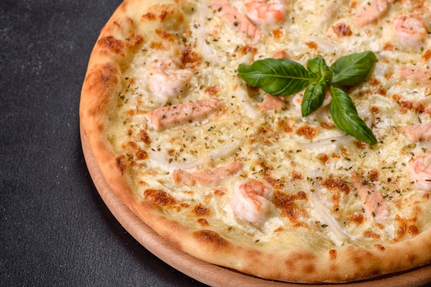 Delicious fresh seafood oven pizza: red fish and shrimp. healthy food. italian cuisine