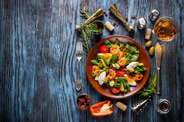 Delicious fresh seafood salad on the old wooden background