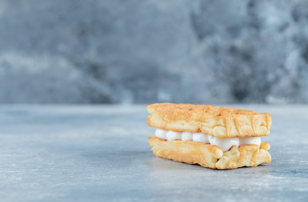Delicious fresh waffle on a gray background.