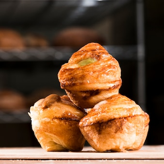 Delicious freshly baked sweet puff pastry on plank over the wooden table