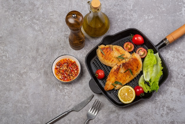 Delicious fried chicken breast and vegetable salad