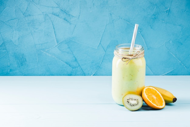 Delicious fruit smoothie copy space