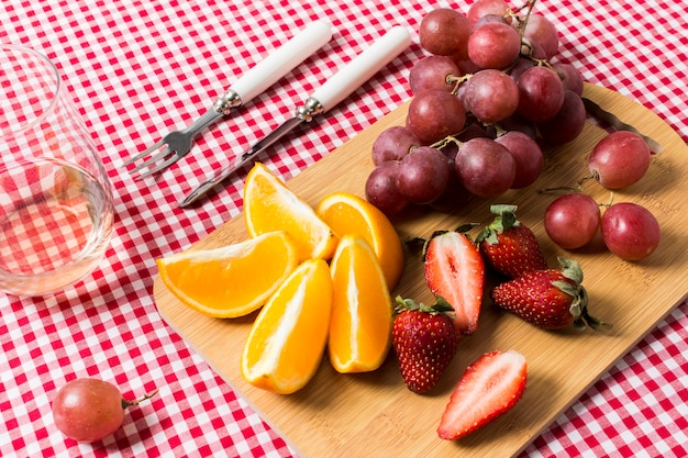 Delicious fruits on kitchen cloth