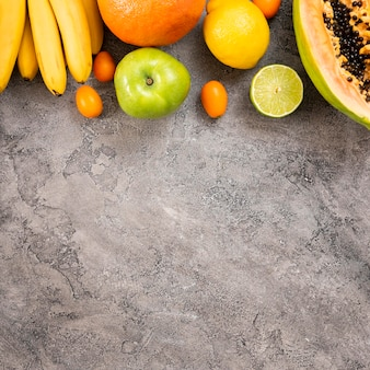 Delicious fruits on stucco background