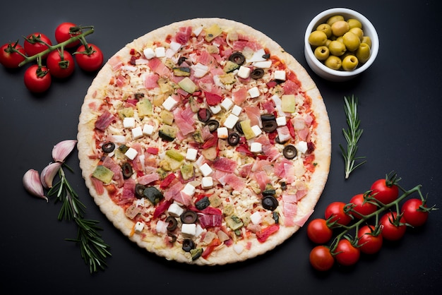 Delicious garnish pizza with various ingredients