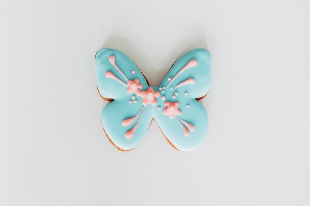 Delicious gingerbread cookies in the form of a blue butterfly.