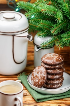 Delicious gingerbread cookies with icing sugar and chocolate for christmas. new year