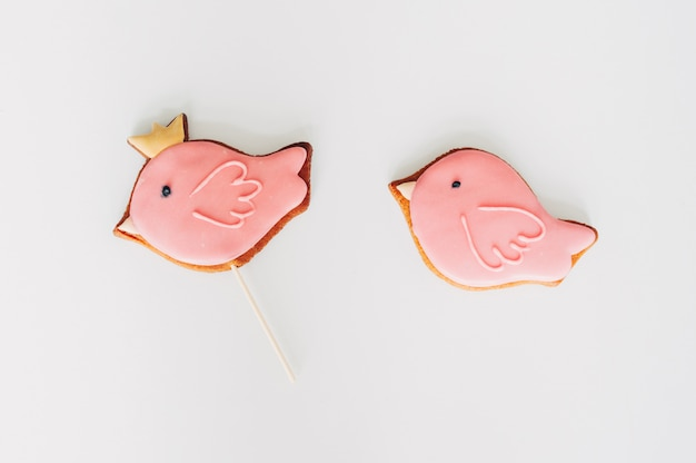 Delicious gingerbread in the form of a pink bird.
