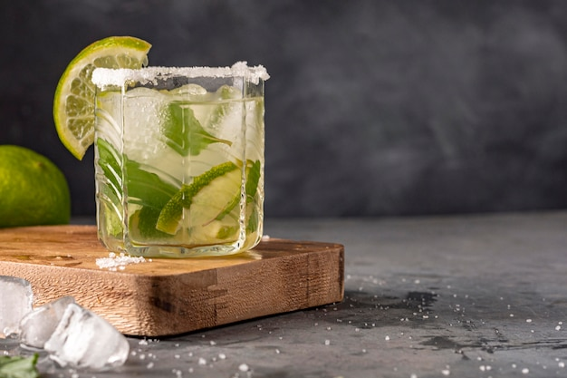Delicious glass with lime drink