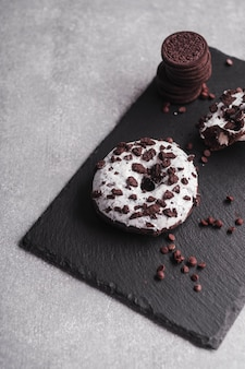 Delicious glazed donuts on stone plate