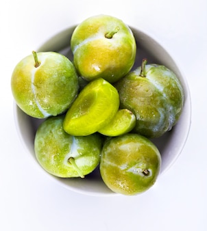 Delicious green plums fresh and raw claudias. isolated