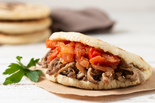 Delicious grilled arepas with meat