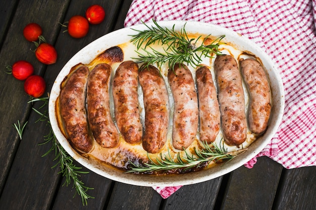 Delicious grilled sausages with potherbs