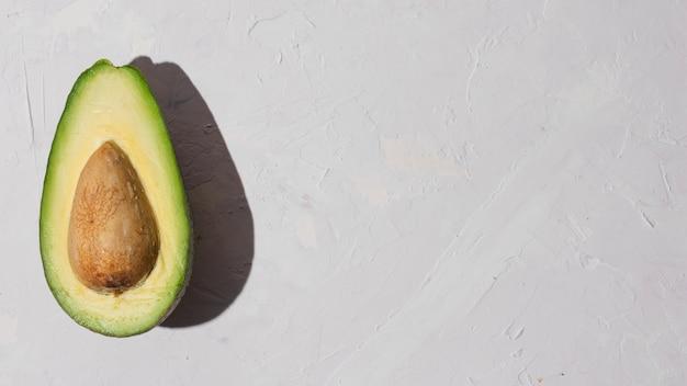 Delicious half avocado with copy space