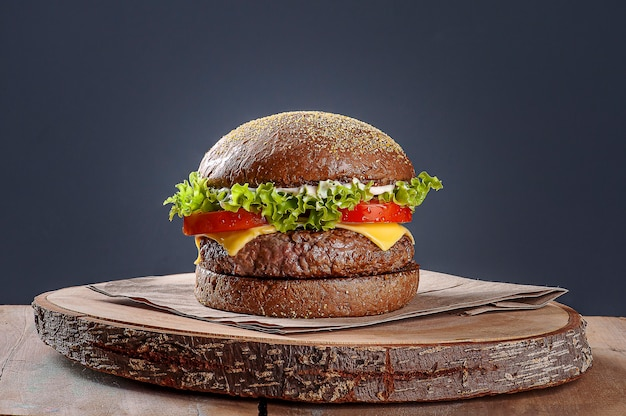 Delicious hamburger served on australian bread. wooden table and gray background. copy space
