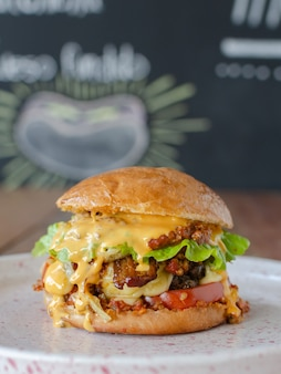 Delicious hamburger with chili and chesse, blackboard background