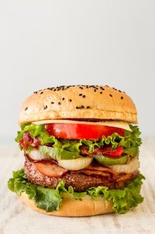 Delicious hamburger with on table