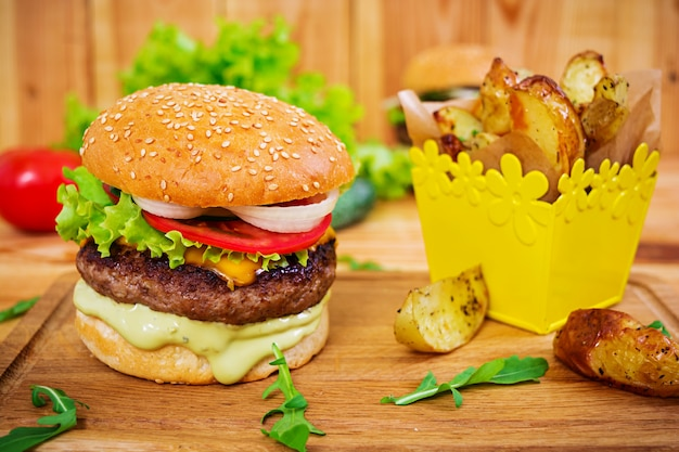 Delicious handmade burger on wooden. close view