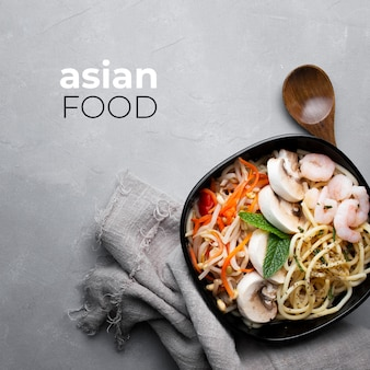 Delicious and healthy asian food on a gray textured background