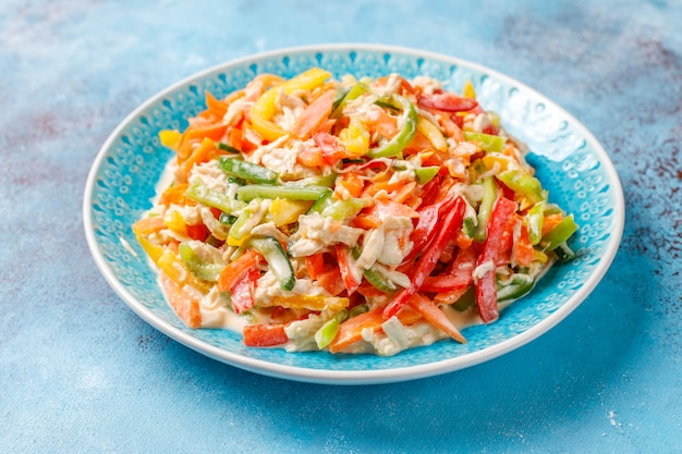 Delicious healthy bell pepper salad with chicken,top view