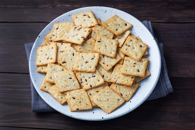 Delicious healthy cookies crackers with flax seeds and sesame seeds on a plate. background of a healthy snack food, close up.