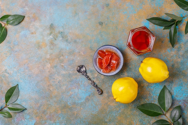Delicious and healthy homemade quince jam in glass,top view