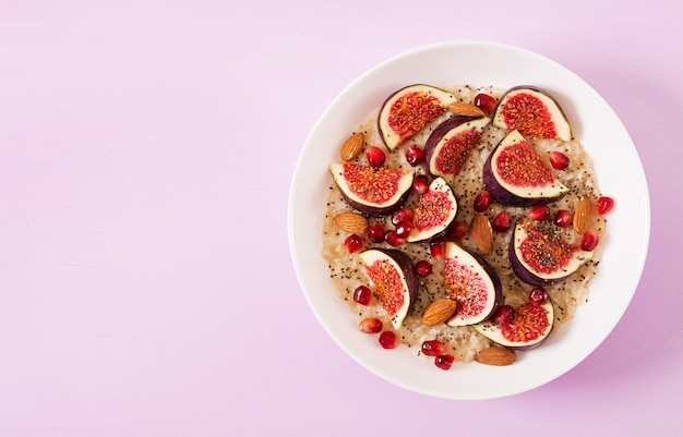 Delicious and healthy oatmeal with figs, almond and chia seeds.