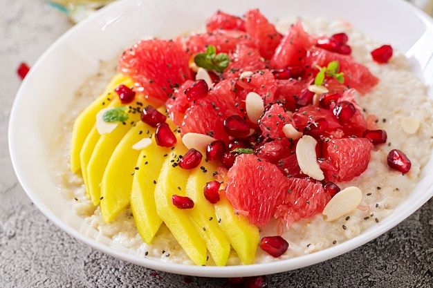 Delicious and healthy oatmeal with grapefruit, pomegranate, almond and chia seeds.  healthy breakfast. fitness food. proper nutrition