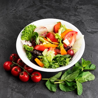 Delicious healthy salad on grunge background