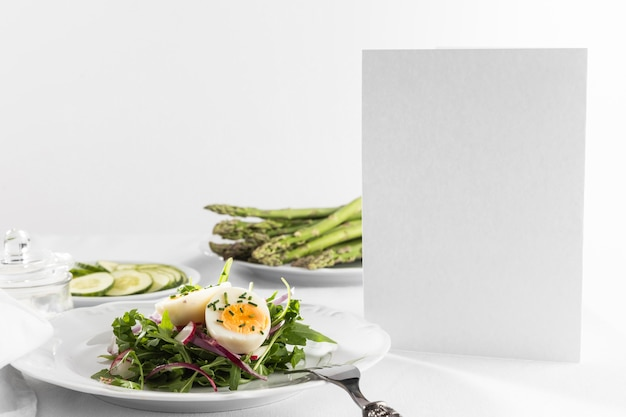 Delicious healthy salad on a white plate composition