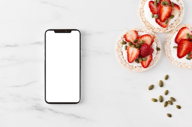 Delicious healthy snack and mobile phone