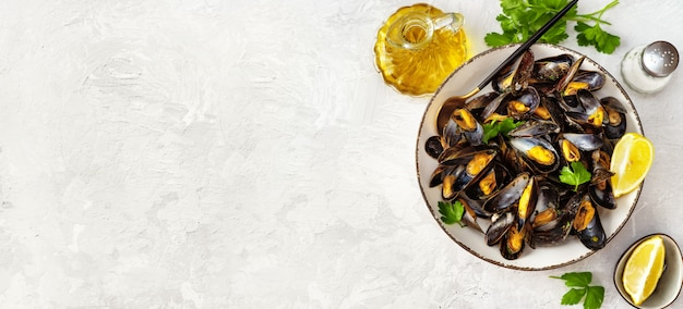 Delicious and healthy steamed mussels on white background