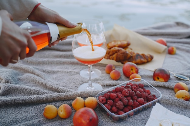 Delicious healthy summer picnic on the grass. fruits on a blancet.