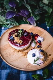 Delicious homemade cheesecake with berry sauce.