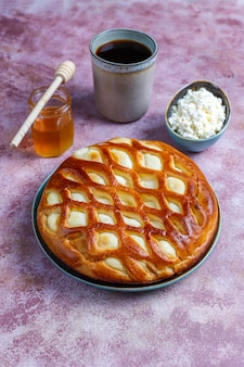 Delicious homemade cottage cheese pie tart with fresh cottage cheese and honey,top view