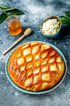 Delicious homemade cottage cheese pie tart with fresh cottage cheese and honey