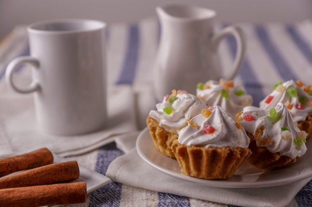 Delicious homemade cupcakes with cream on a plate.