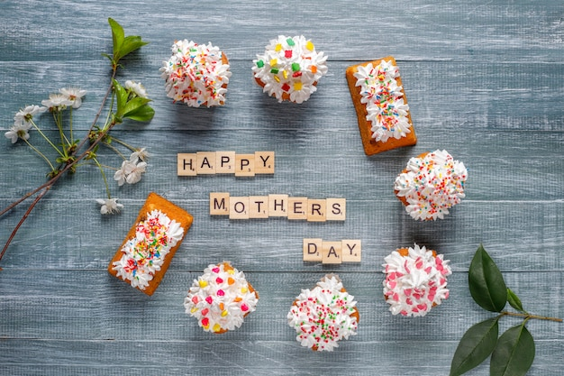 Delicious homemade cupcakes with various sprinkles and happy mothers day words