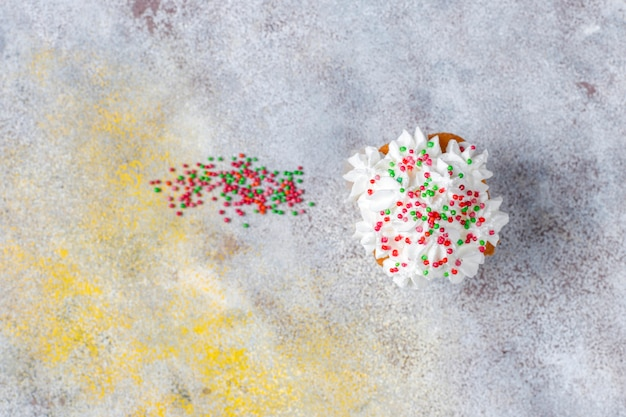 Delicious homemade cupcakes with various  sprinkles
