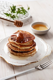 Delicious homemade pancakes with honey