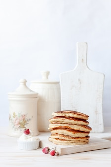 Delicious homemade pancakes with sour cream and berries