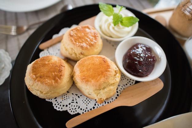 Delicious homemade scones with fresh strawberry jam and cream