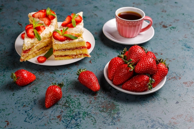 Delicious homemade strawberry cake slices with cream and fresh strawberries,top view