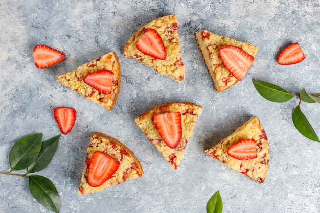 Delicious homemade strawberry crumble cake with fresh strawberry slices, top view