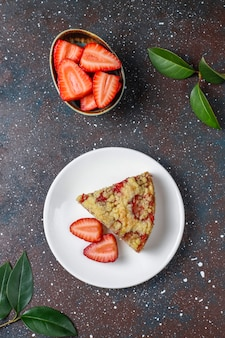 Delicious homemade strawberry crumble cake with fresh strawberry slices
