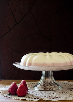 Delicious homemade strawberry mousse cake with fresh strawberries and cream