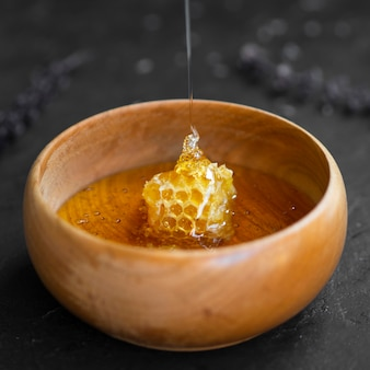 Delicious honeycomb in wooden bowl